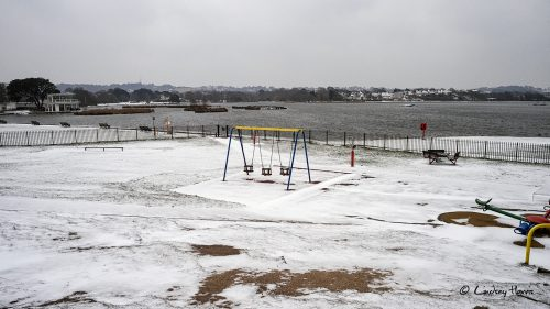 Playground in the snow at Poole Park, Poole, Dorset. 2018.
