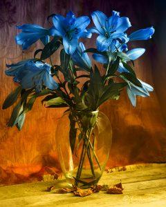 Vase of blue lilies.