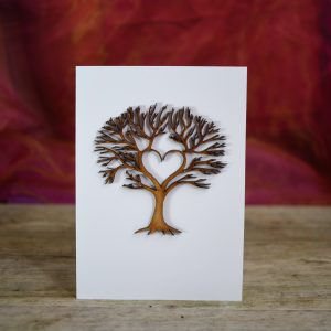 Wooden tree card with a heart carved into it.