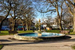 The fountain in the sunshine at Parkstone Park (aka The Green), Ashley Cross, Lower Parkstone, Poole, Dorset.
