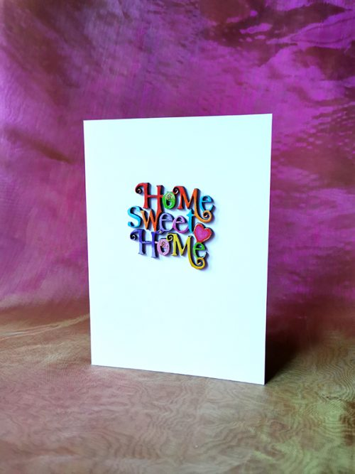 New home 3D wooden card, hand with letters handpainted in a different colour.