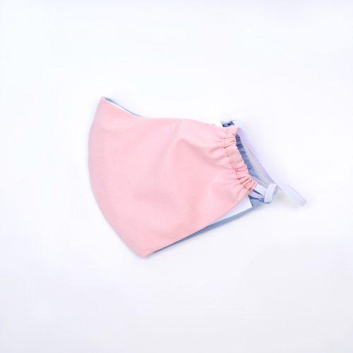 Pink & baby blue harlequin design face mask.