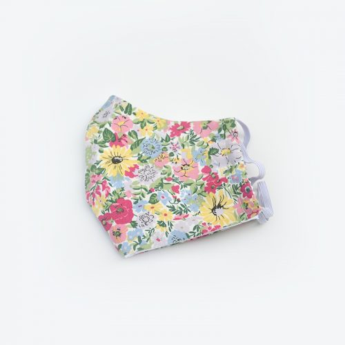 'Malvern Meadow' Liberty print face mask, with spring flowers.