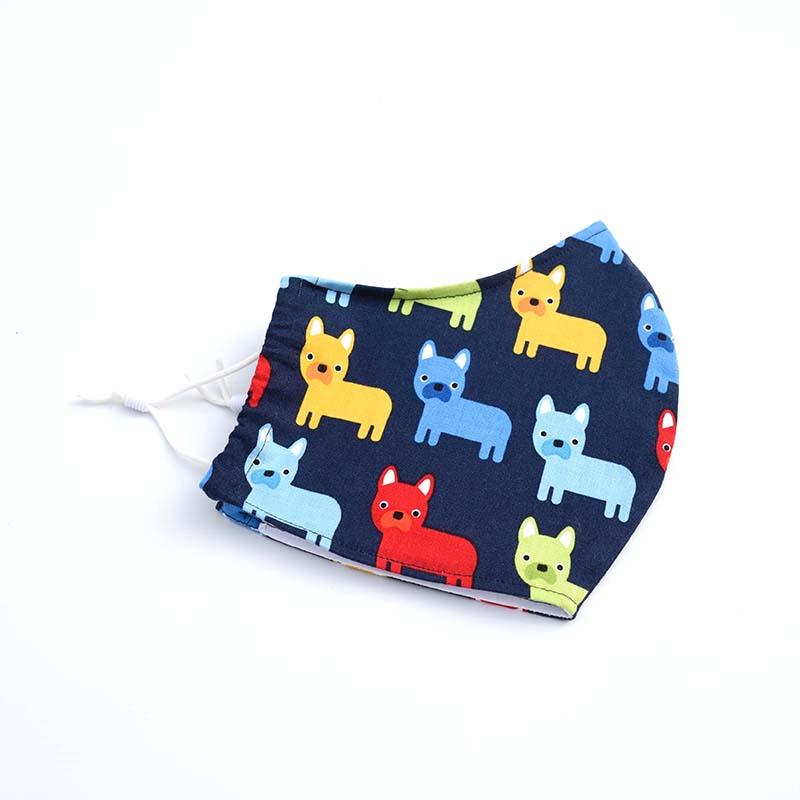100% cotton fitted face mask with brightly coloured dogs.