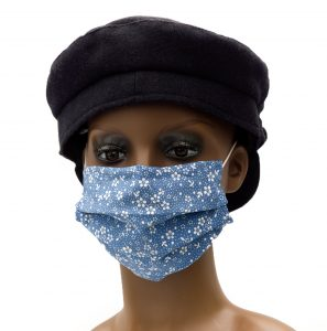 Blue cotton face mask with white flowers. Nose wire and insert for filter. Adjustable loops that go round the ears.