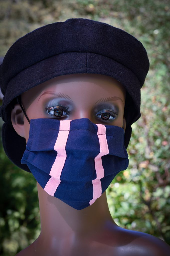 Blue face mask with two pink stripes. Handmade in Dorset.