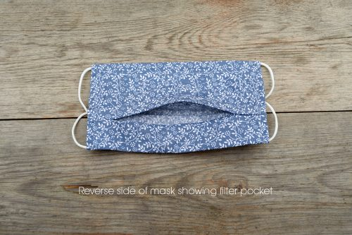 Reverse of steel Blue 'Climbing Leaves' face mask, in 100% cotton.