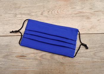 Pleated royal blue face mask, 100% cotton, with nose wire and space for filter.