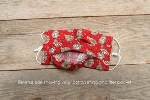 Reverse side of red Paisley face mask, 100% cotton with nose wire & filter pocket.