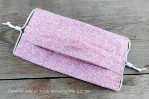 Reverse of pretty pink face mask, with nose wire & filter pocket. 100% cotton.