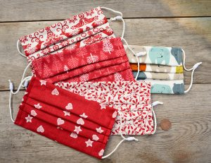 Yuletide face coverings for sale, 100% cotton, nose wire & filter pocket.