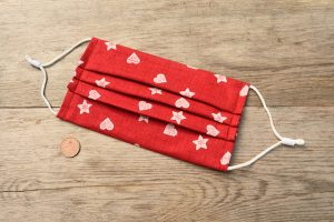 Hearts & stars face covering in red.