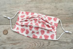Pretty cotton face mask with hearts, nose wire and filter pocket.