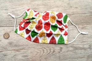 Autumn leaves face mask, with nose wire and filter pocket. 100% cotton.