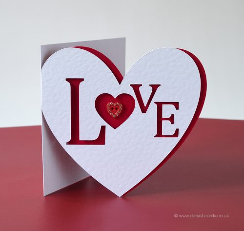 Red heart shaped card for Valentine's Day.