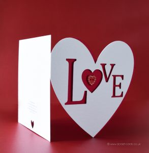 Red heart shaped 'Love' card with diamante heart for Valentine's Day.