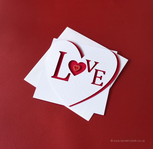 Red heart shaped card with diamante heart for Valentine's Day.