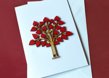 Tree Of Love, Valentine's Day card. Tree with multiple red hearts and two golden leaves.
