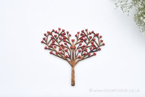 Wooden tree with red hearts fridge magnet.