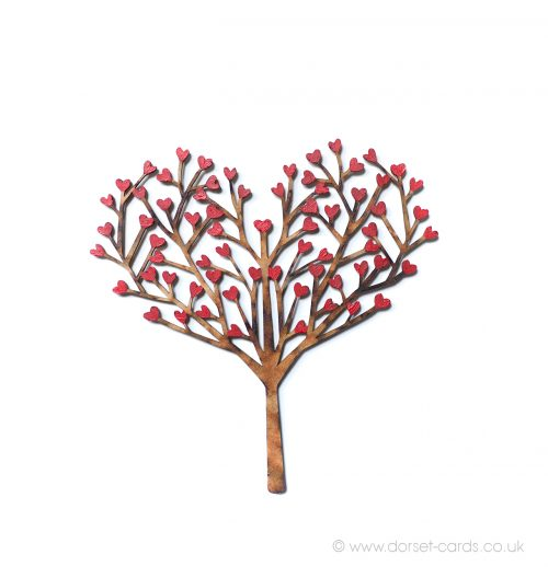 Wooden tree fridge magnet, with heart-shaped leaves.